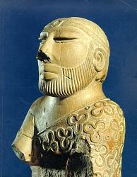 Mohenjo Daro statue of Indus priest or king wearing a scarf or stole